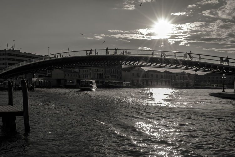 Modern Constitution Bridge (Ponte della Costituzione) over Grand Canal, black and white. The pedestrian bridge connects the north of the city with the mainland and the rail terminal. Be. Ready. Cityscape Costituzione Grand Canal Modern Santiago Calatrava Travel Venice, Italy View Architecture Black And White Bridge City Constitution Della Europe Landmark Outdoors Pedestrian Ponte Sky Sun Sunlight Urban Water