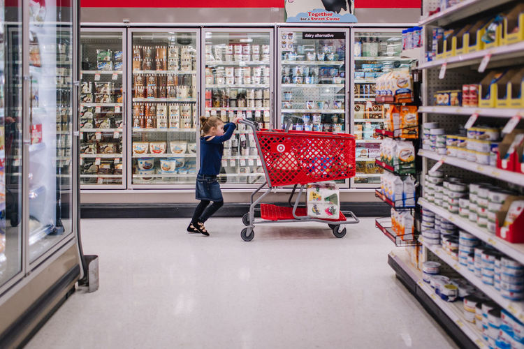 Girl grocery shopping Retail  Store Supermarket Shopping Full Length One Person Choice Customer  Consumerism Shopping Cart Groceries Indoors  Food And Drink Target Girl