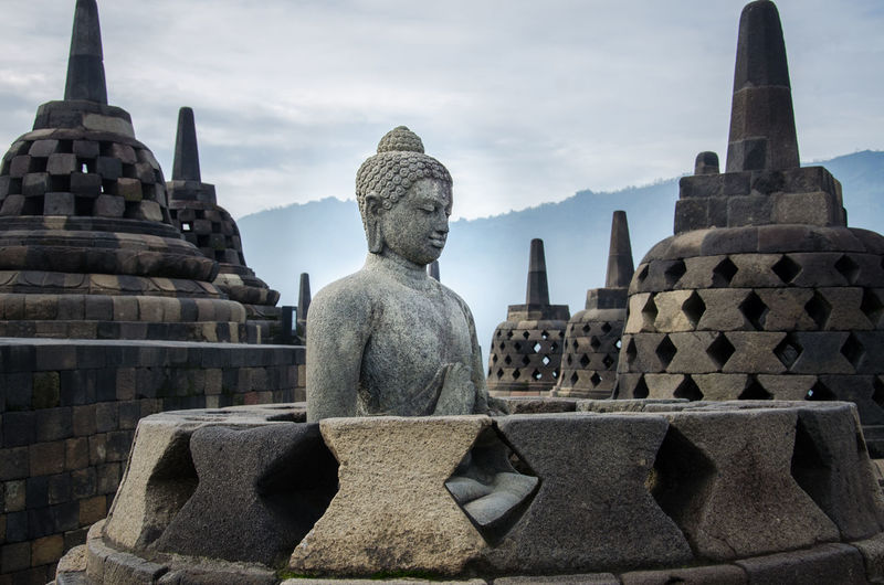 Ancient Architecture Borobudur Buddha Built Structure Calm Cloud - Sky Day Gaudi Gold History Jogja Jogjakarta No People Old Ruin Outdoors Place Of Worship Religion Spirituality Statue Stone Material Tranquil Tranquility Travel Destinations Yogjakarta