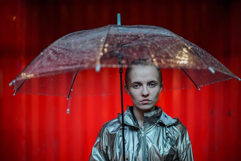 Rain Red Portrait Front View Protection Looking At Camera Weather One Person Young Adult Young Women Wet Outdoors Lifestyles One Young Woman Only Real People Day One Woman Only Close-up Adult Adults Only