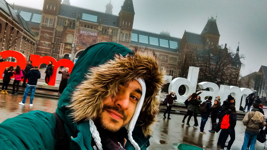 Iamamsterdam Cold Temperature Travel Destinations Adventures In The City Winter Art Holanda Holland Amsterdam Rijksmuseum Amsterdam Rijksmuseum Tourism Winter Men Building Exterior Architecture City City Life Adult People Group Of People Street Young Adult Crowd Warm Clothing