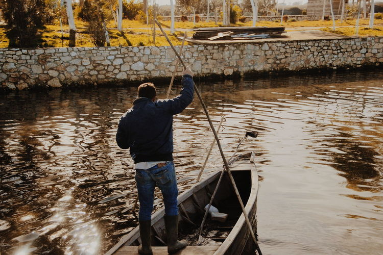 Water One Person Occupation Reflection One Man Only Men Adult Real People Standing Adults Only Working Day Manual Worker People Outdoors Only Men Flood Nature