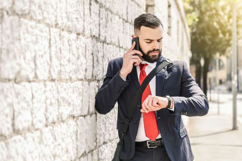 Model: Roberto Materiale Adult Architecture Business Business Person Businessman Communication Connection Corporate Business Front View Holding Males  Men One Person Outdoors Suit Technology Well-dressed Wireless Technology Young Adult Young Men