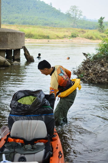 Water Outdoors Chiang Rai, Thailand Real People People Men Day River Nature Transportation Two People Lifestyles Mode Of Transportation Leisure Activity Males  Child Life Jacket Sitting Childhood