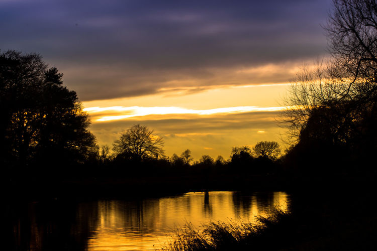 Alone Bushy Park EyeEm Best Shots Fiery Sunset... Landscape_Collection Moody Sky Winter Beauty In Nature Colours Of Nature Deep Thoughts Eyeem Photography Landscape_photography Nature No People Orange Color Outdoors Reflection Scenics Silhouette Sky Sunset Tranquil Scene Tranquility Tree Water