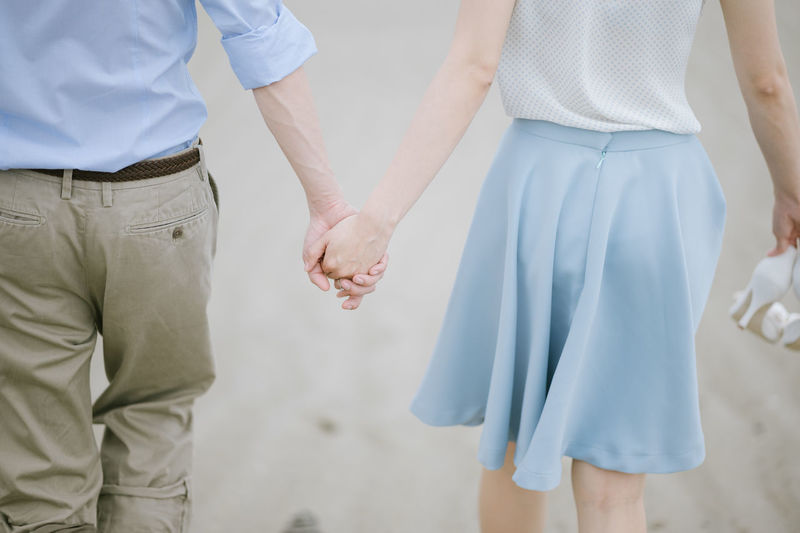 Two People Midsection Holding Hands Love Real People Positive Emotion Women Standing Adult Casual Clothing Togetherness Bonding Rear View Men Couple - Relationship Lifestyles Emotion People Focus On Foreground Friendship Hand Holding Hands