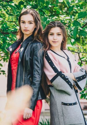 Two People Friendship Young Adult Togetherness Young Women People Portrait Long Hair Casual Clothing Adults Only Outdoors Adult Leisure Activity Front View Day Arm In Arm Only Women Looking At Camera Standing Bonding Beautiful People Girls Love Teenager Red