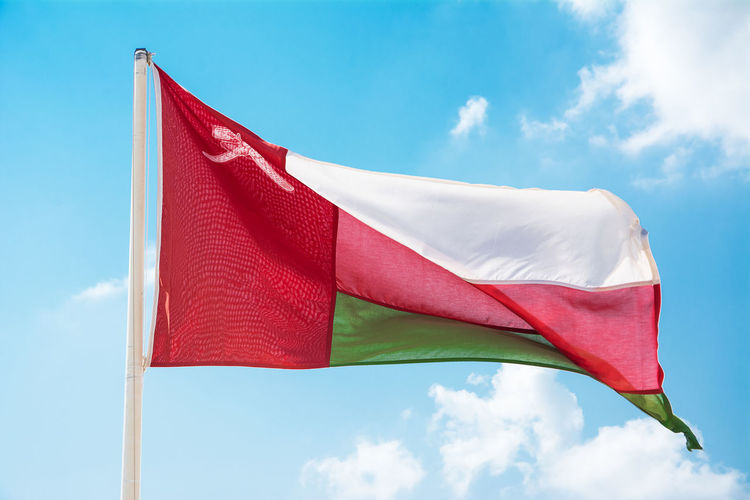 waving flag Flag Sky Flagpole Flagstaff Sultanate Of Oman Oman Patriotism Wind Pride Pole No People Low Angle View