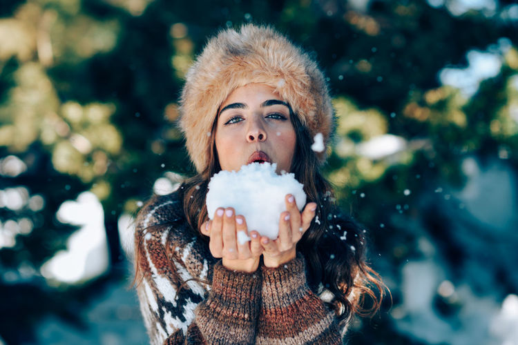 Portrait of woman with ice cream in winter