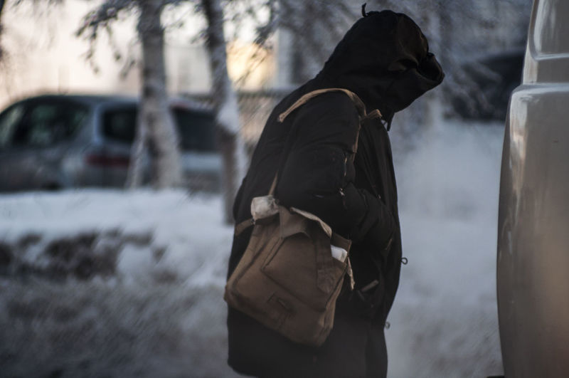 Rear view of man during winter