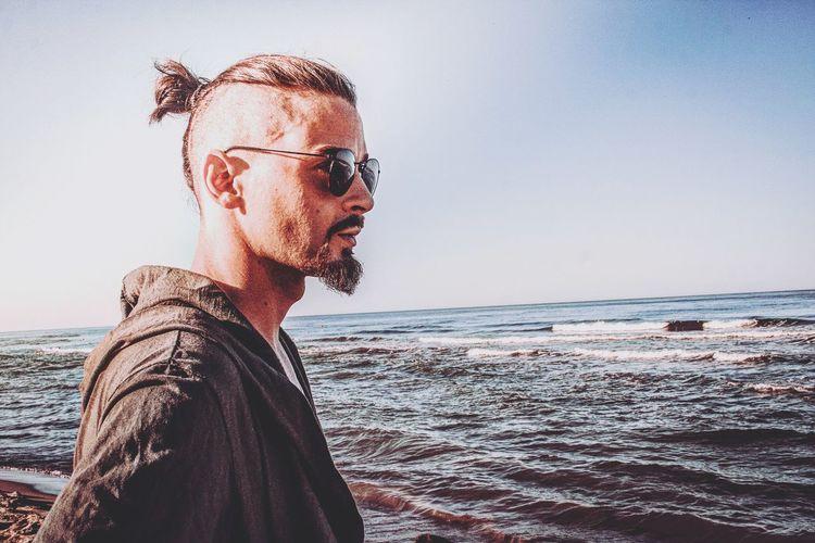 ▪FREEDOM ᴛʜᴇʀᴇ ɪs ᴘʟᴇᴀsᴜʀᴇ ɪɴ ᴛʜᴇ ᴘᴀᴛʜʟᴇss ᴡᴏᴏᴅs, ᴛʜᴇʀᴇ ɪs ʀᴀᴘᴛᴜʀᴇ ɪɴ ᴛʜᴇ ʟᴏɴᴇʟʏ sʜᴏʀᴇ, ᴛʜᴇʀᴇ ɪs sᴏᴄɪᴇᴛʏ ᴡʜᴇʀᴇ ɴᴏɴᴇ ɪɴᴛʀᴜᴅᴇs, ʙʏ ᴛʜᴇ ᴅᴇᴇᴘ sᴇᴀ, ᴀɴᴅ ᴍᴜsɪᴄ ɪɴ ɪᴛs ʀᴏᴀʀ; ɪ ʟᴏᴠᴇ ɴᴏᴛ ᴍᴀɴ ᴛʜᴇ ʟᴇss, ʙᴜᴛ ɴᴀᴛᴜʀᴇ ᴍᴏʀᴇ. ● ○ IG: @ Model Shooting Photography Fashion Young Adult Young Men Market EyeEm Selects Water Sea Beach Men Eyeglasses  Summer Mid Adult Sky Horizon Over Water Close-up Wave Calm Sunset Coast Posing