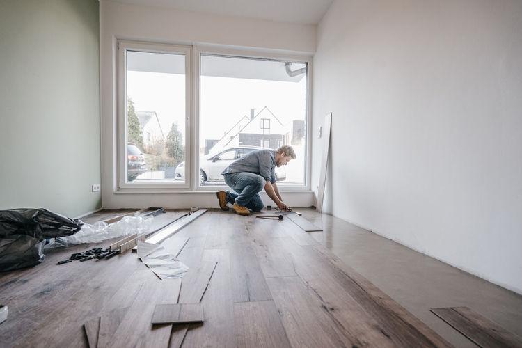 Man on hardwood floor at home