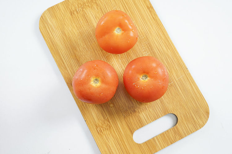 High angle view of tomatoes on cutting board