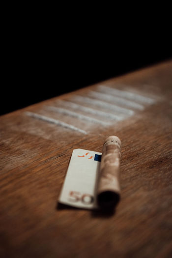 Addiction Black Background Close-up Cocaine D Day Euros Indoors  Money No People Selective Focus Still Life Table Vertical Wood - Material