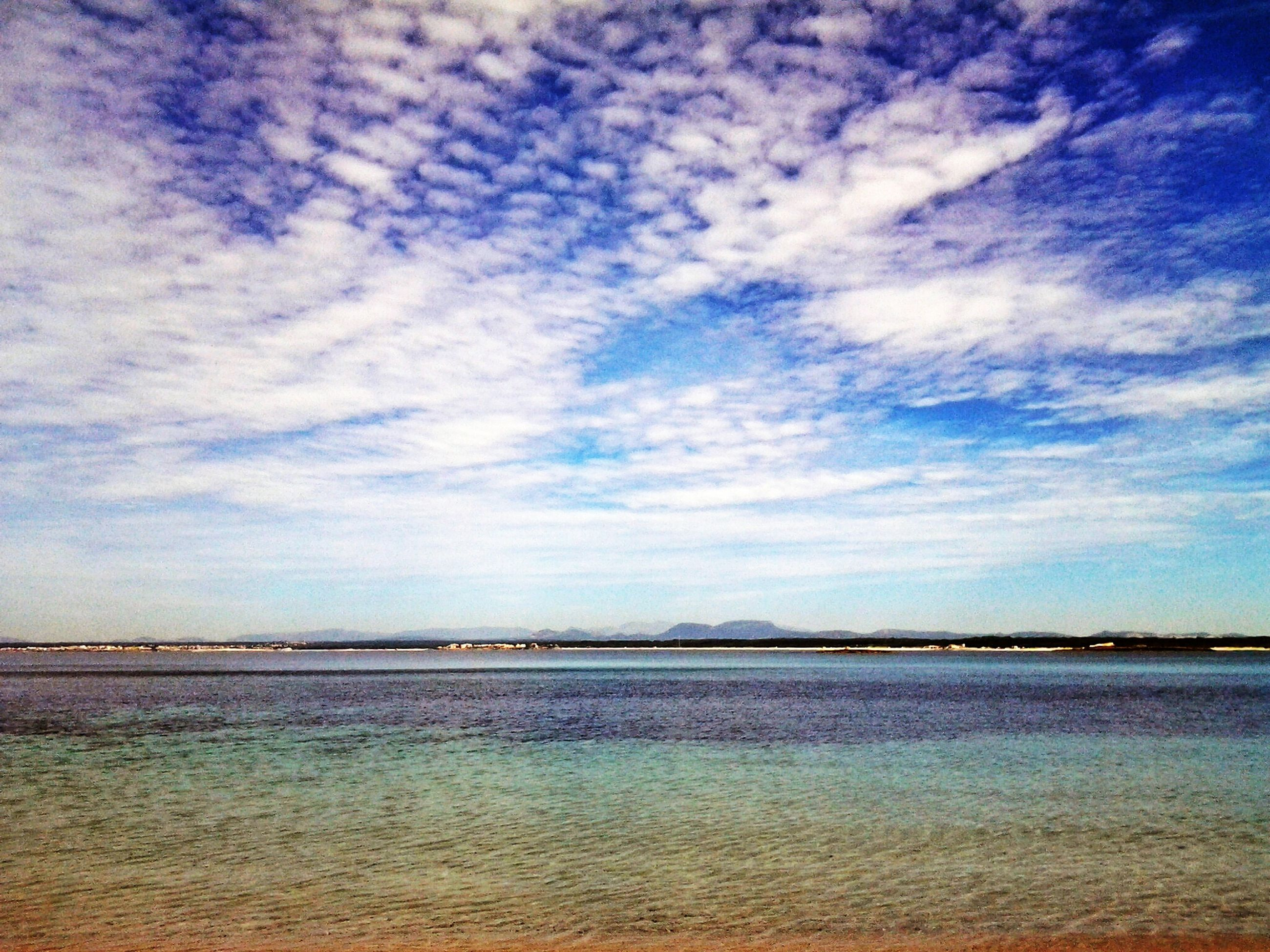 water, sea, sky, tranquil scene, tranquility, scenics, beach, beauty in nature, cloud - sky, horizon over water, blue, waterfront, cloud, nature, shore, idyllic, cloudy, sand, calm, rippled