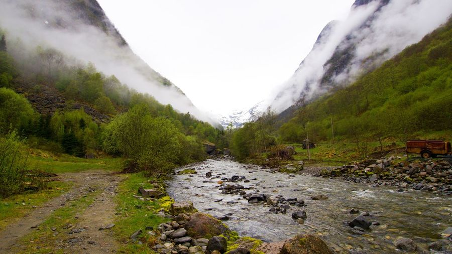 Early morning with beautiful clouds, slowly disappearing as the sun rises. Nature Beauty In Nature Tranquil Scene Tranquility Mountain Non-urban Scene No People Environment Day Landscape Flowing Water Stream - Flowing Water Foggy Morning Fog Norway