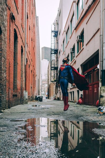 Be. Ready. Superman Streetphotography Seattle Architecture Built Structure Building Exterior Real People Reflection Day Lifestyles Men Outdoors City Water One Person Full Length Sky Puddle Adult People