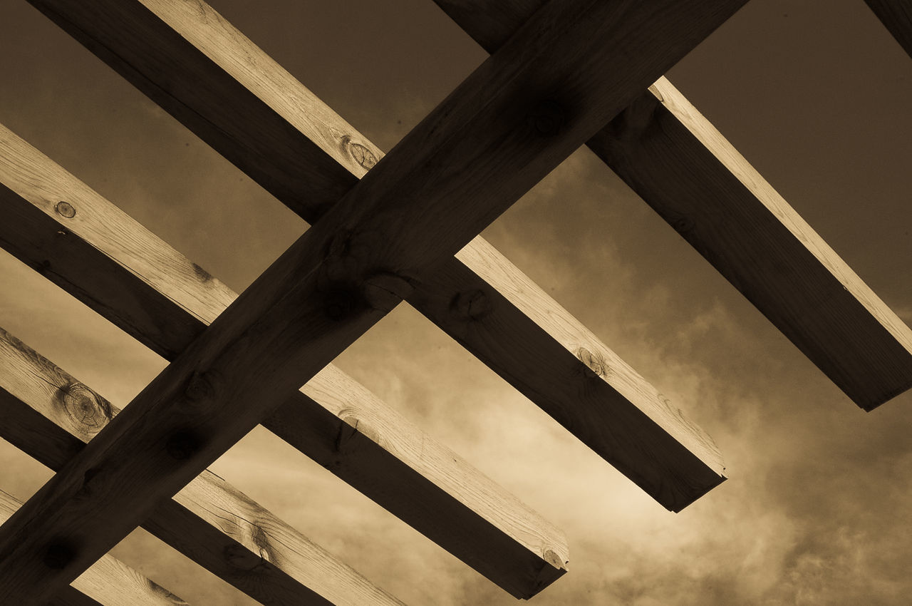 low angle view, architecture, built structure, no people, roof beam, day, architectural column, sky, outdoors, girder, close-up