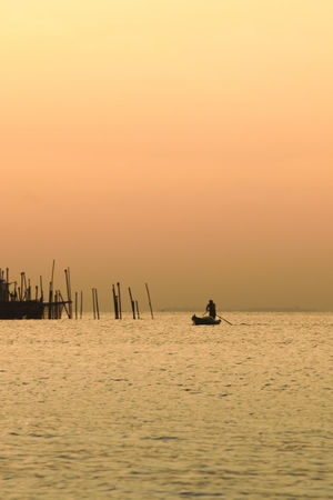 Sunset Sea Water Nautical Vessel Outdoors Silhouette No People Day Sea View Seaside Fisherman Nautical Theme Waterscape Seascape Sea And Sky Beauty In Nature Nature Mode Of Transport Transportation Nature_collection Sunlight Sunset_collection Sunset Silhouettes Sunshine One Person TCPM