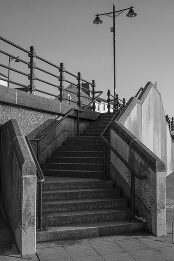 Porthcawl Architecture Built Structure Clear Sky Day Hand Rail Lookingup Low Angle View Monochrome No People Outdoors Railing Sky Staircase Stairs Stairway Steps Steps And Staircases Street Light Street Photography The Way Forward