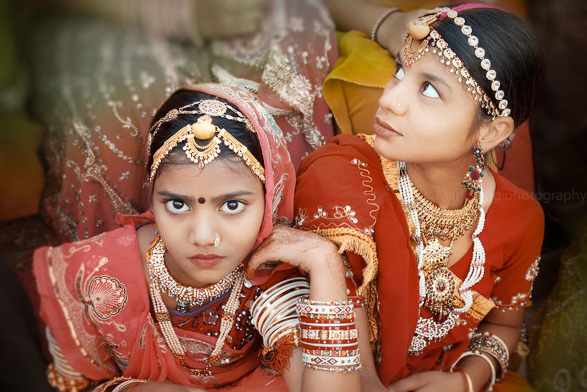 Young girls wearing beautiful sarees and jewelry for a Hindu festival in Rajasthan, India. Beautiful Beauty Childhood Close-up Cultures Cute Eyes Faces Festival Focus On Foreground Front View Girls Hinduism India Indian Culture  Jewelry Lifestyles Multi Colored People Portrait Rajasthan Sari Two Udaipur Girl Power
