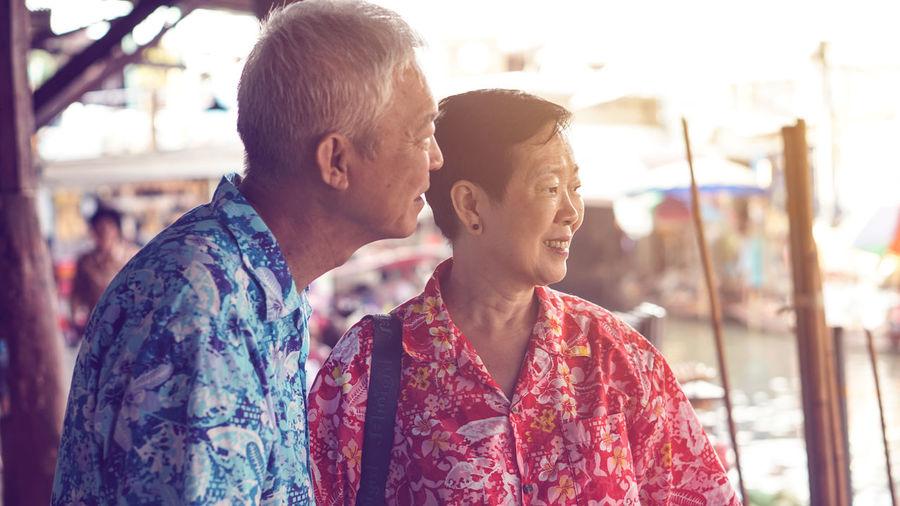 Asian senior couple trip to thailand floating market exotic southeast asia trip