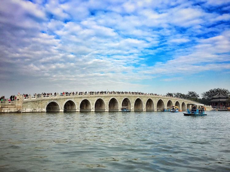 Architecture Arch Water Sky Built Structure Travel Destinations Waterfront Tourism Nature Scenics Beauty In Nature River Cloud - Sky Connection Day Outdoors Bridge - Man Made Structure No People