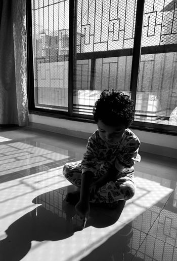 Lost in the moment... EyeEmNewHere Memoriesforlife Memories, Talking Photos Light EyeEm Best Shots EyeEmNewHere EyeEm Gallery EyeEm Selects Eye4photography  EyeEmBestPics EyeEm Best Edits Eyeemphotography Childhood Blackandwhite Child Baby Window Moments Childhood Full Length Child Sitting Window Babies Only One Baby Girl Only Looking Through Window