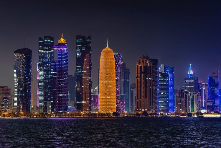 Doha Cornish Architecture Building Exterior Building Built Structure Skyscraper City Office Building Exterior Night Urban Skyline Modern Illuminated Waterfront Landscape Travel Destinations Cityscape Sky Residential District
