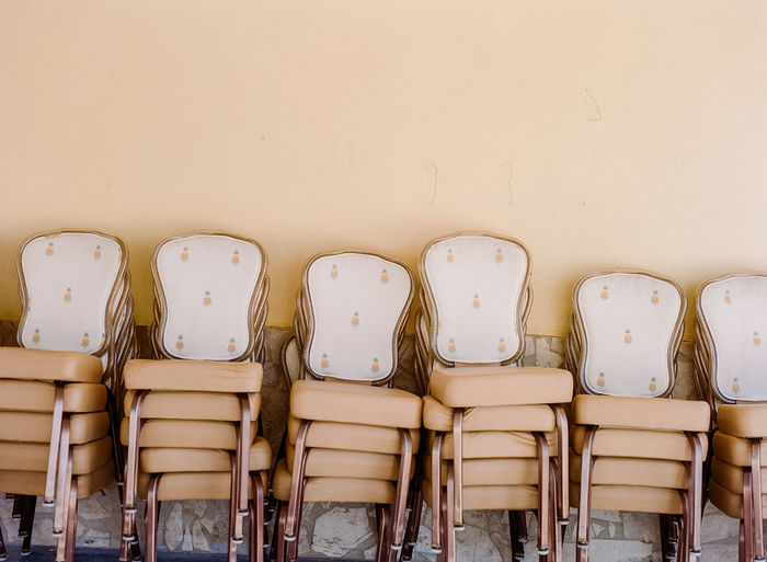 Empty Chairs Arranging Against Wall