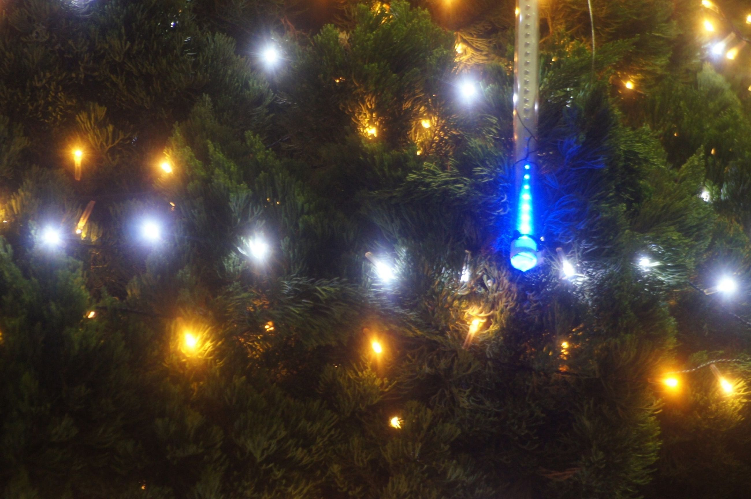 illuminated, night, lighting equipment, street light, celebration, glowing, decoration, electricity, electric light, light - natural phenomenon, christmas, city, no people, low angle view, outdoors, christmas lights, sphere, sky, dark, christmas decoration