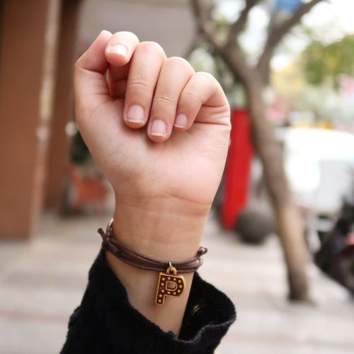 Cropped Hand Of Woman Wearing Letter P Bracelet