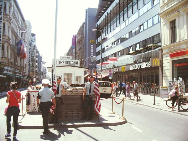 Capture Berlin Berlin Germany City Building Exterior City Street Built Structure Large Group Of People Architecture Travel Destinations Outdoors City Life Day People Adults Only Sky Adult americans Checkpointcharlie Checkpoint Charlie