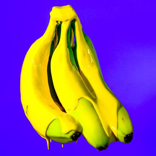 These unripe bananas needed some colour..... Yammy Banana Bananen Blue Background Close-up Creativity Fresh Fresh On Eyeem  Fruit FUJIFILM X-T2 Liquid Macro Photography Minimal Obst Pop Art Simple Photography Studio TakeoverContrast Unreif Vibrant Color Yellow Visual Feast
