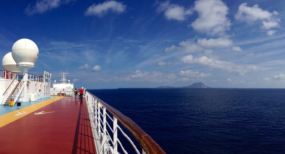 Cruise ship sailing in sea against blue sky