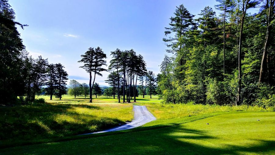 Panoramic view of golf course against sky