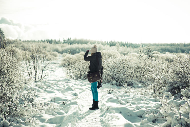 exploring winter Exploring Wanderlust Winter Woman Cold Temperature Girl Land Landscape Lifestyles Nature One Person Outdoors Plant Real People Rear View Warm Clothing Winter