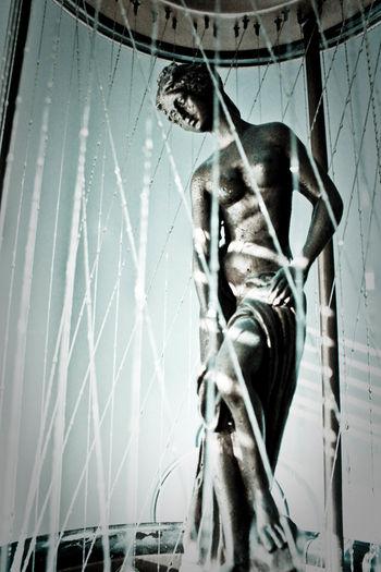 Goddess Statue Aphrodite Venus Rain Lamp Strings Afternoon Cool Tones Pose Antique Vintage Seductive