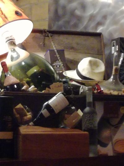 Close-up of wine bottles on table at home