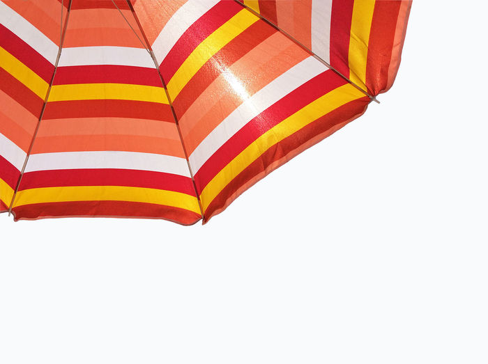 Under my umbrella Striped White Background Pattern No People Textile Umbrella Protection Multi Colored Security Single Object Low Angle View Day UV  UV Protection Sunlightreflection Shades of Winter Isolated Under Umbrella Burning Sun Sun Protection Summer Vacations Beach Conceptual EyeEmNewHere