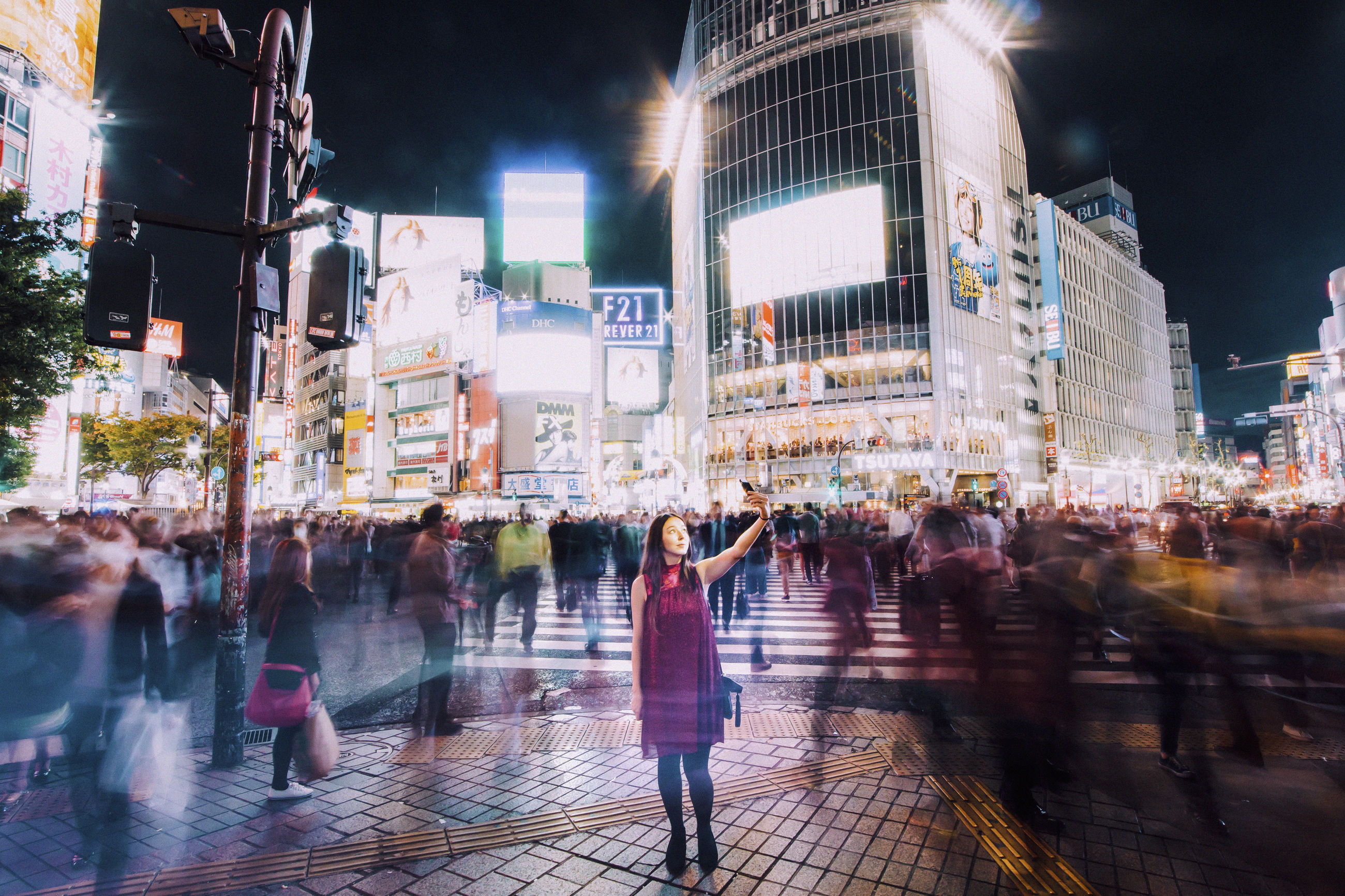 city, night, building exterior, real people, illuminated, architecture, group of people, blurred motion, built structure, motion, large group of people, crowd, city life, street, women, adult, walking, lifestyles, men, outdoors, office building exterior, busy