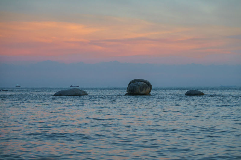 Three boulders on the sea surface Beauty In Nature Cloud - Sky Horizon Horizon Over Water Idyllic Marine Nature No People Outdoors Rock Rock - Object Scenics - Nature Sea Sky Solid Sunset Tranquil Scene Tranquility Water Waterfront