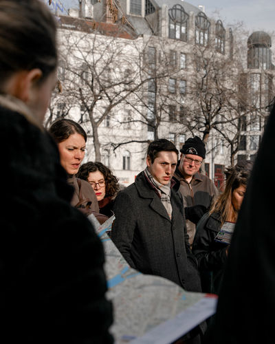 Briefing Listening Warm Clothing Coat Scarf Tour Walking Tour Group Travelling Travel The Traveler - 2018 EyeEm Awards The Portraitist - 2018 EyeEm Awards Tree City Snow Winter Men Cold Temperature Bare Tree Togetherness Visiting Winter Coat The Street Photographer - 2018 EyeEm Awards