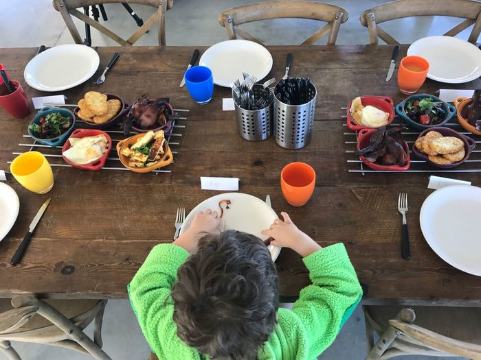 High Angle View Of Boy Eating Food At Home