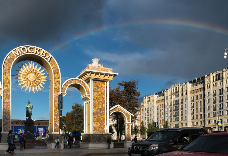 Russia, Moscow, rainbow, Tverskaya street, Pushkin Square Arch Arched Architecture Blue Building Exterior Built Structure Car City City Life Day Famous Place Land Vehicle Mode Of Transport Monument Outdoors Place Of Worship Rush Hour Russia, Moscow, Rainbow, Tverskaya Street, Pushkin Square Sky Street Tall - High Transportation