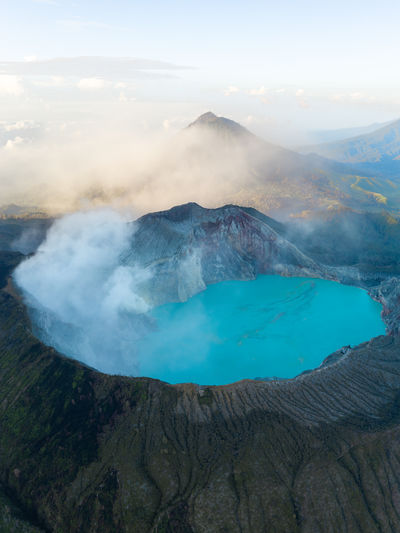 Aerial view of ijen crater from top in banyuwangi, indonesia.