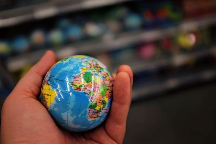 Close-up of hand holding globe