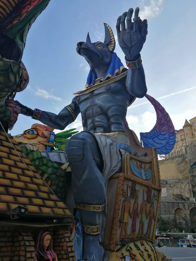 Maiori, Campania, Italy - March 4, 2019: Allegorical floats in the square of the port for the 46th edition of the Grand Carnival of Maiori Italy Campania Salerno Italy Grand Carnival Of Maiori Amalfi Coast Colorful Floats Carnival - Celebration Event Allegorical Floats Maiori, Day Sky Representation Art And Craft Low Angle View Human Representation Sculpture Statue Creativity Craft Male Likeness No People Cloud - Sky Sunlight Outdoors