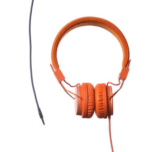 Orange Headphones on white Background Cable Close-up Communication Computer Cable Connection Connection Block Day Electrical Equipment Headphones Network Connection Plug No People Product Product Photography Sound Technology White Background