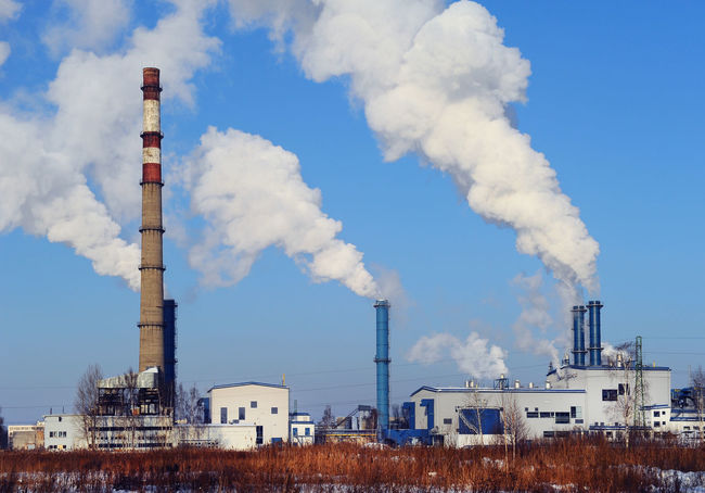 Power plant in Riga, Latvia Chimney Chimney Smoke Latvia Plant Power Plant Smoke Smoke Stack Steam Architecture Building Built Structure Chemistry Day Environment Environmental Damage Factory Factory Building Heating Heating Station No People Outdoors Polluted Polluted Nature Riga Sky
